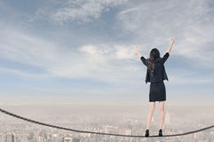 Standing on rope and feel exciting. Asian business woman standing on rope and feel exciting, concept about adventure, risk, success, win etc Royalty Free Stock Photography