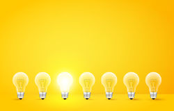 Standing in a row light bulbs with glowing one on yellow background. Unlike others or odd man out concept. Vector. Standing in a row light bulbs with glowing one Royalty Free Stock Photo