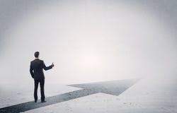 Standing salesman looking ahead with arrow Stock Images