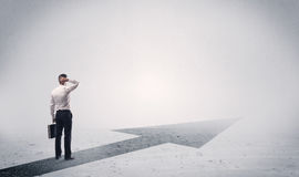 Standing salesman looking ahead with arrow Stock Photos