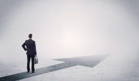 Standing salesman looking ahead with arrow Stock Image