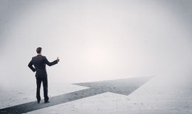 Standing salesman looking ahead with arrow Royalty Free Stock Images