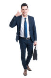 Standing salesman making call me gesture Stock Photo