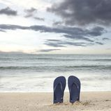 Standing sandals on beach Royalty Free Stock Image