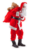 Standing Santa with a bag of gifts. Standing Santa Claus with a bag of gifts. Isolated on white Stock Photo