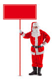 Standing Santa Claus with a sign. In his hand. Isolated on white Royalty Free Stock Image