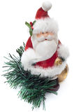 Standing santa sculpture with pine branches Royalty Free Stock Photos