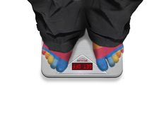 Standing On The Scale Royalty Free Stock Photos