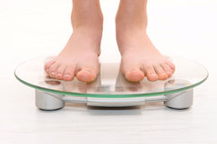 Standing on scales Royalty Free Stock Photo