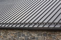 Free Standing Seam Modern Metal Roof Over Vintage Stone Wall Stock Image - 148474971