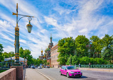 Standing on The Second Sadovy bridge and watching a purple car passing by. Royalty Free Stock Photos