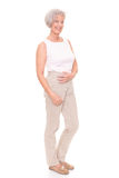 Standing senior woman stock images
