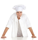 Standing serious male cook Stock Images