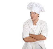 Standing serious male cook Royalty Free Stock Photos