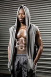 Standing shirtless man with grey jumper Stock Images