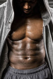 Standing shirtless man with grey jumper. At the crossfit gym Royalty Free Stock Image