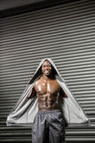 Standing shirtless man with grey jumper. At the crossfit gym Stock Images