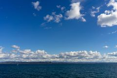 Bright Sunny Day in Lake Neuchatel royalty free stock image