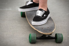 Standing on Skateboard Royalty Free Stock Images