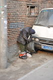 Standing while sleeping. A poor man sleeping standing in Bejing hutong Royalty Free Stock Image