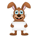 Standing and smiling brown rabbit Stock Image