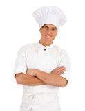 Standing smiling male cook Stock Photos