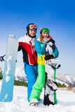 Standing smiling snowboarders with boards Stock Photos