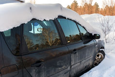Standing in the snow, snowbound car. Royalty Free Stock Photography