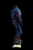 Standing snowboarder isolated, rear view Royalty Free Stock Images
