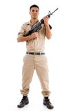 Standing soldier posing with gun Stock Images