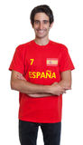 Standing spanish sports fan with black hair Stock Image