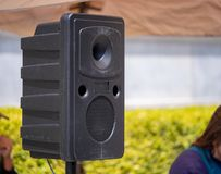 Standing speaking projecting music at a musical performance stock photo