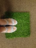 Standing on a Square of Artificial Grass Stock Photo