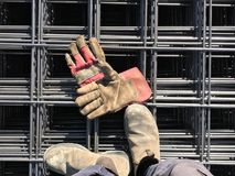 At Work. Standing on a steel net Royalty Free Stock Photos