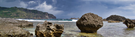 Standing Still. Rock formations along the rugged shoreline of Batan island Royalty Free Stock Photography