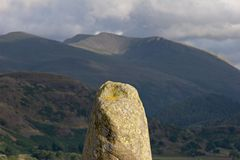 Standing stone. Part of Castlerigg Stone Circle, English Lake District. A stone-age ceremonial and religious center, the form of this stone mirrors the form of Stock Photo