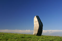Standing Stone. Avebury, England on grass with a blue sky Royalty Free Stock Images
