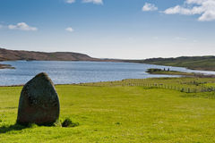 Standing stone and Finlaggan Royalty Free Stock Image
