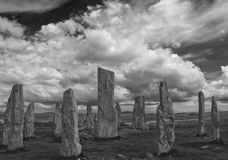 Standing Stones. Circle of standing stones, Callanish,  Isle of Lewis, set against sky of low cumulus cloud. Converted to black and white to enhance appreciation Stock Photography