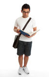 Standing student reading book studying Stock Image