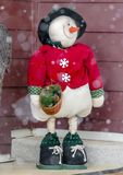 Standing stuffed snowman on the porch of a home royalty free stock photography