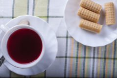 Standing on the table white Cup of tea hibiscus. The view from the top Royalty Free Stock Photos