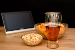 Standing tablet with unhealthy snack isolated on black backgroun Stock Photo