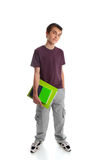 Standing teen student. Young male teen school student wearing t-shirt and cargoes.  He is carrying textbook and folder Stock Photography
