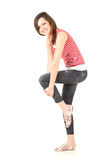 Standing teenage woman stretching, full length Stock Photography