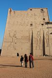 Standing by Temple of Edfu Stock Photos