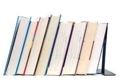 Standing on textbooks. Decor with standing hardcover books on isolated white Stock Photos