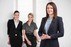 Standing together in bright modern office Royalty Free Stock Image