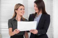 Standing together with document in light modern office Royalty Free Stock Image