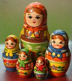 Standing together. A set of wooden Russian nesting dolls of decreasing size. Can be placed one inside another Royalty Free Stock Image